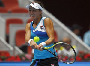 Romania's Niculescu returns the ball during her semi-final match against Germany's Petkovic at the China Open tennis tournament in Beijing