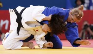 Romania's Alina Dumitru fights with Japan's Tomoko Fukumi in women's -48kg semi-final A judo match at London 2012 Olympic Games