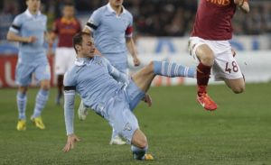 AS Roma's Alessandro Florenzi is challenged by Lazio's Stefan Radu during their Italian serie A soccer match at the Olympic stadium in Rome