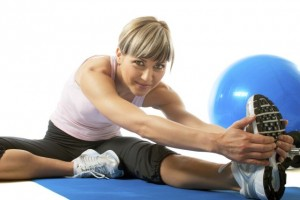 Sportswoman stretching