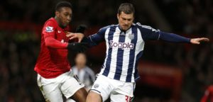 Manchester United's Welbeck challenges West Bromwich Albion's Tamas during their English Premier League soccer match at Old Trafford in Manchester