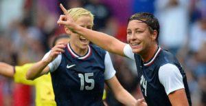 US' forward Abby Wambach (R) celebrates