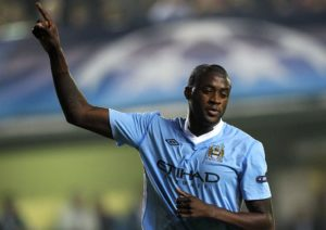 Manchester City's Yaya Toure celebrates after scoring his team's third goal during their Champions League Group A soccer match against Villarreal at the Madrigal stadium in Villarreal