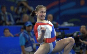 ROMANIAN ANDREEA RADUCAN RAISES HER FIST IN GYMNASTICS VICTORY AT THE SYDNEY OLYMPIC GAMES