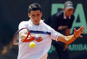 Hanescu returns the ball to Endara during their Davis Cup tennis match in Bucharest